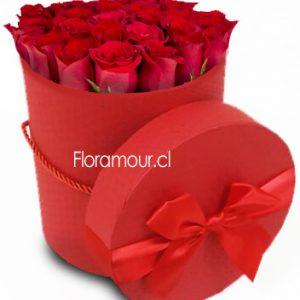 Exclusiva caja redonda vintage con 21 rosas ecuatorianas.